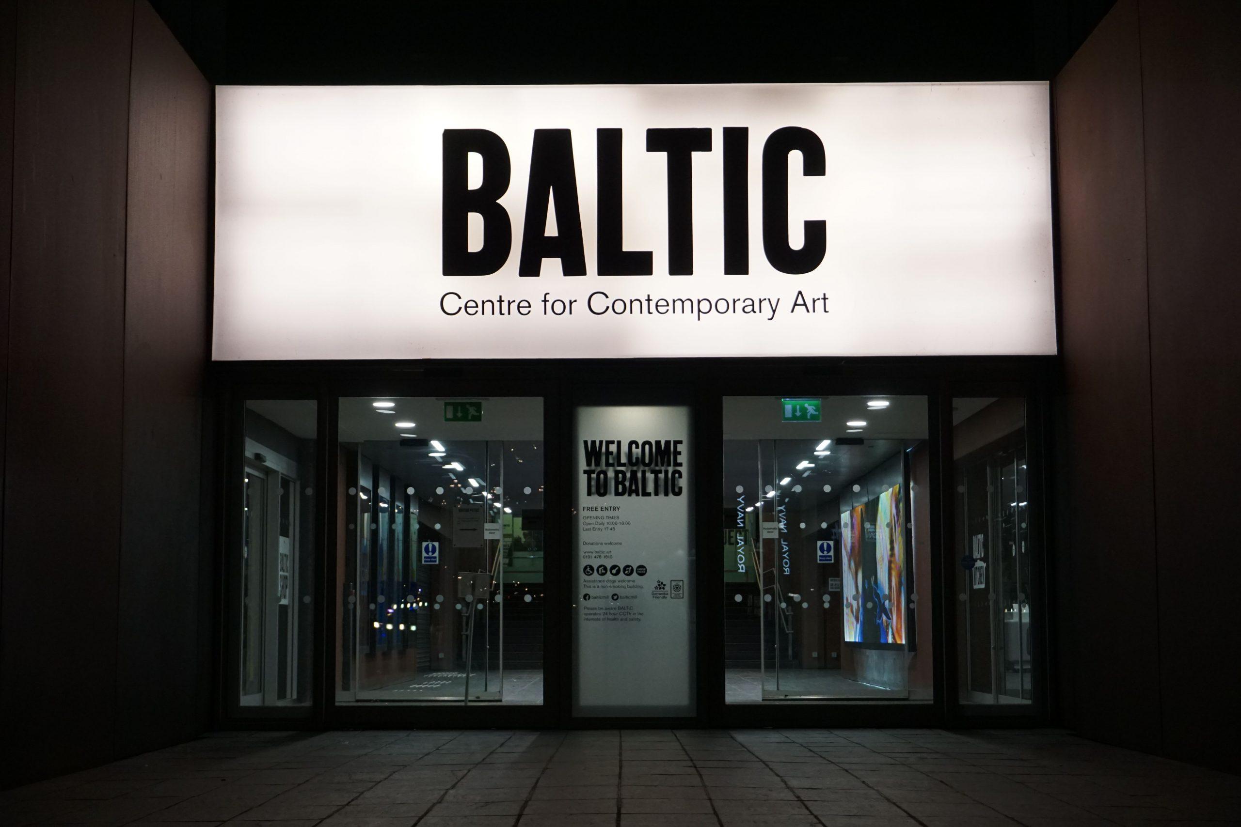 Baltic Art Center in Newcastle at night, neon light sign dominates the scene