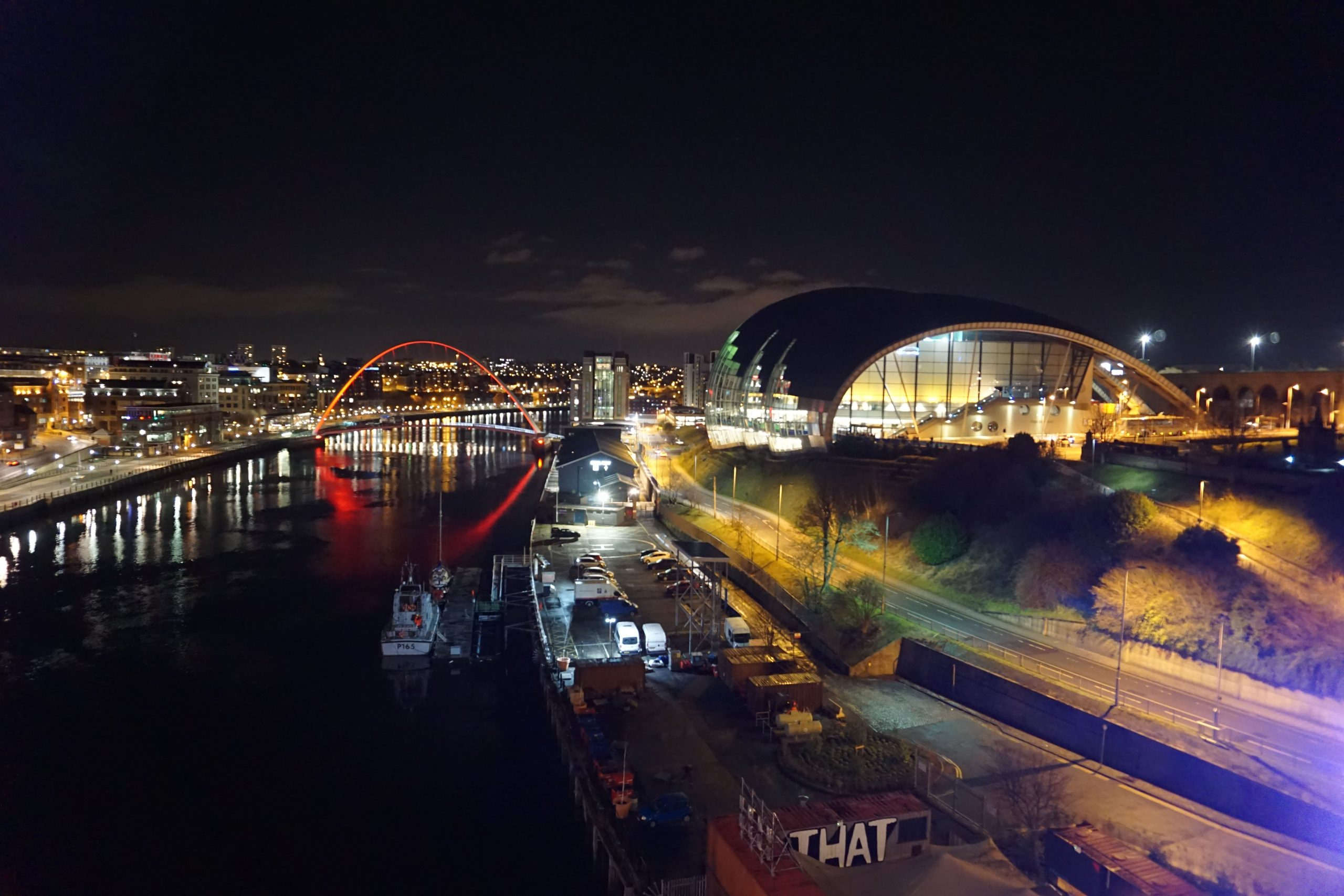 View of River Tyne, Millennium bridge and Gateshead Sage from Tyne Bridge in Newcastle at night.