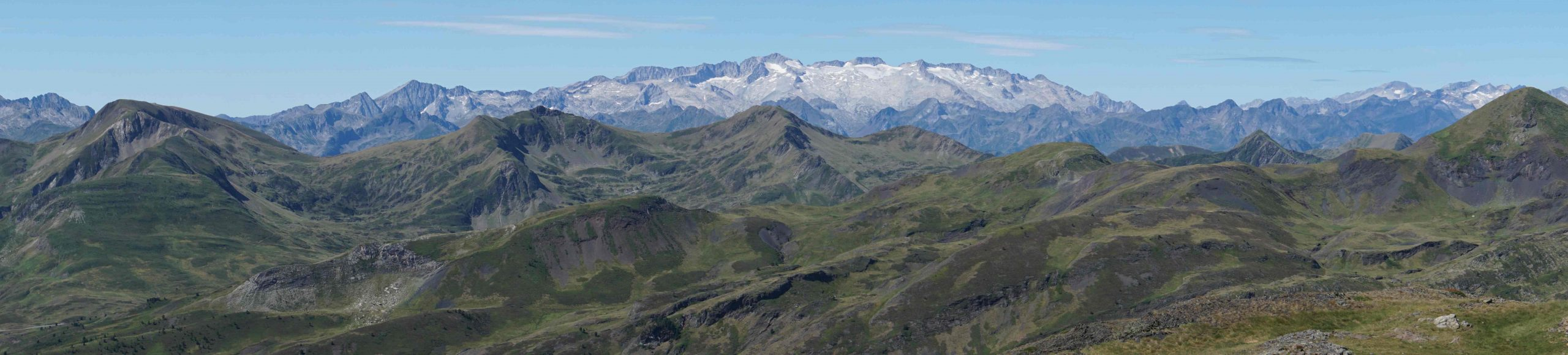 Panorama photo of large snowy mountain range in the Pyrenees